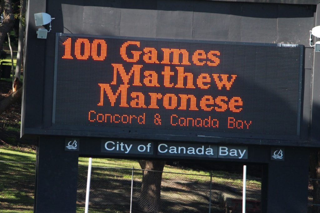 Scoreboard with Mathew Maronese 100 game acnowledgement