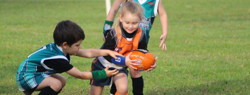 Auskick girl with ball