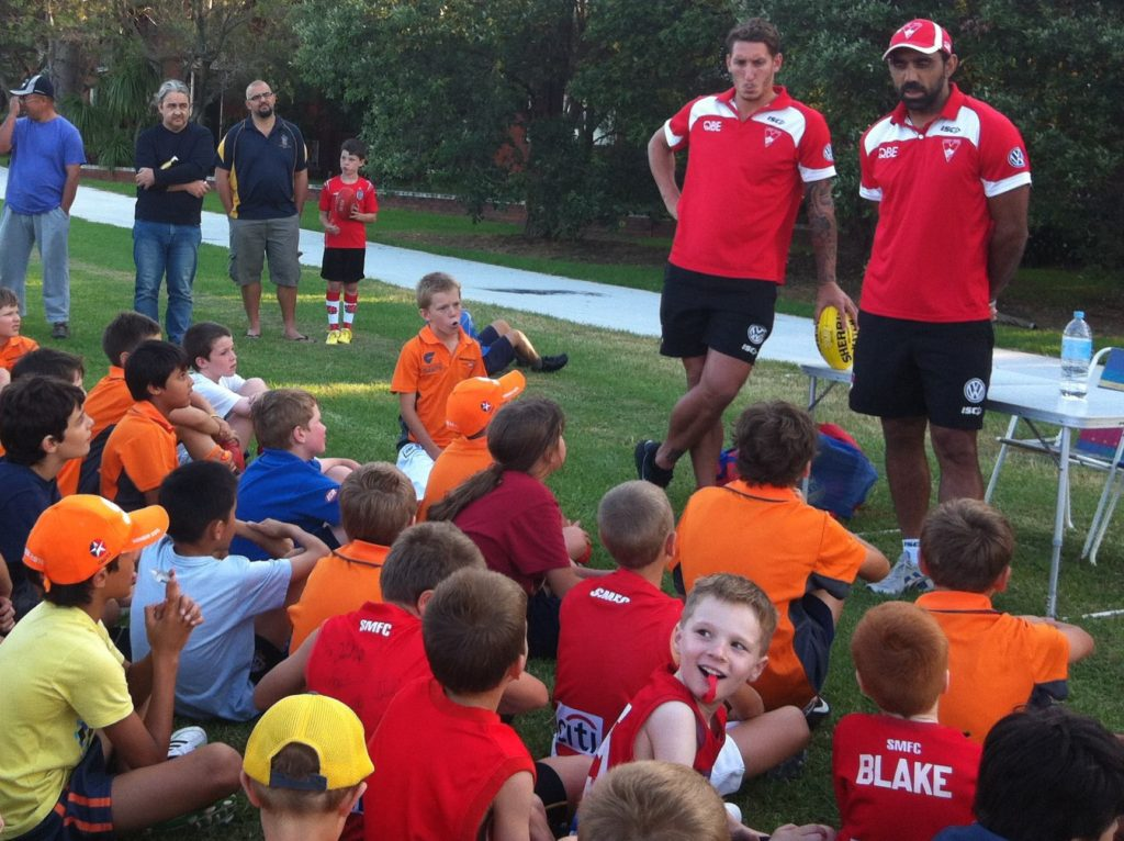 Players with Adam Goodes, Sydney Swans visit 2013