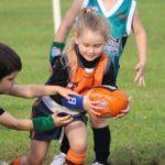 Auskick girl with ball