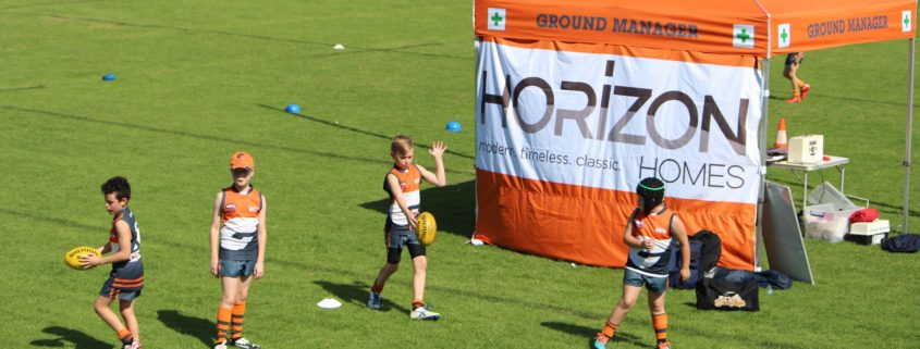 Kids kicking near Horizon Homes Sponsor Banner