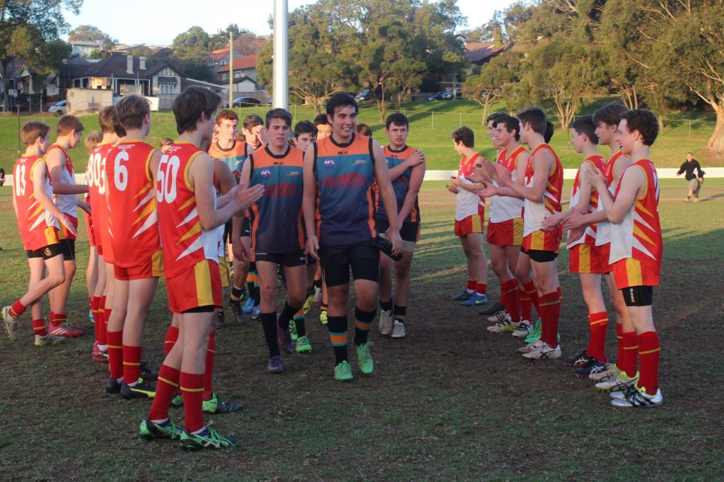 Harrison Lee leads U17s off field
